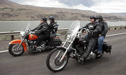 two couples ridining motorcycles