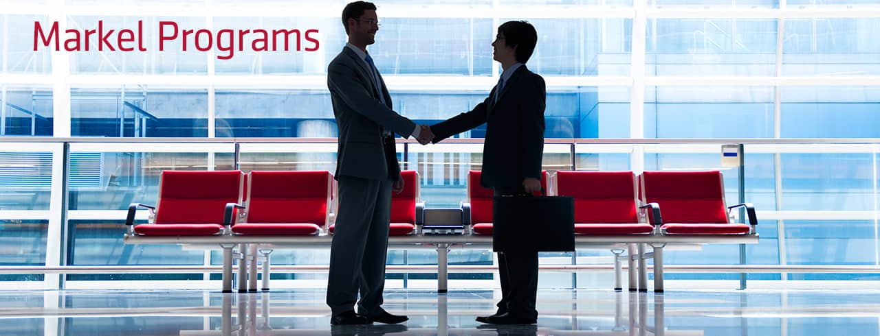 Men shaking hands in an office lobby