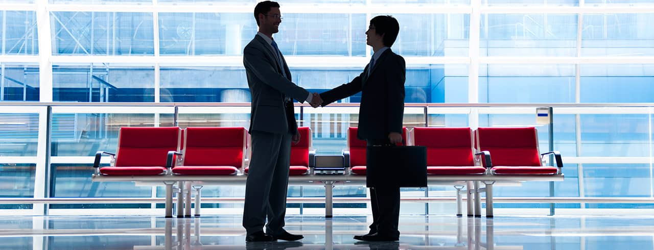 Handshake in office lobby