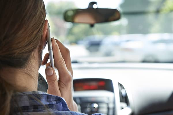 Woman on the phone while driving