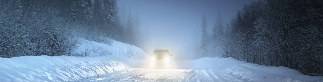 car driving on a snow covered road